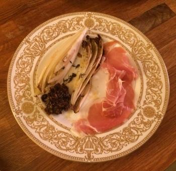Roasted chicory, San Daniele ham, black olive and fig chutney